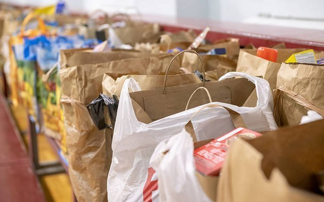 Bagged food items are seen inside Greece's St. Charles Borromeo gym Dec. 14 for the church's food-outreach ministry. (Courier photo by Jeff Witherow)