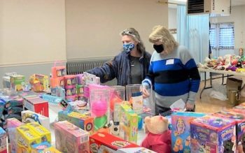 Melissa Swansbrough and Sheryl Raftis look over toys during Tioga County Rural Ministry's toy distribution Dec. 10 at the Veterans of Foreign Wars Post No. 1371 in Owego. (Photo courtesy of Sister Mary O'Brien)