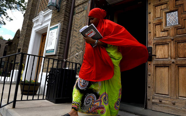 A women steps out of Mary's Place Refugee Outreach in Rochester in 2016. (Courier file photo)