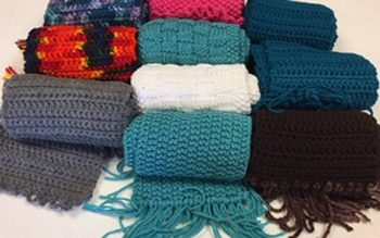 Blankets are just some of the knitted and crocheted items made by members of the Eucharia Ministry at St. Christopher Parish in North Chili. (Photo courtesy of Sheila Wimer)