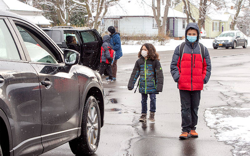Leo (left) and Isaac Weaver leave Rochester's St. Ambrose Academy at the end of the school day Jan. 22.