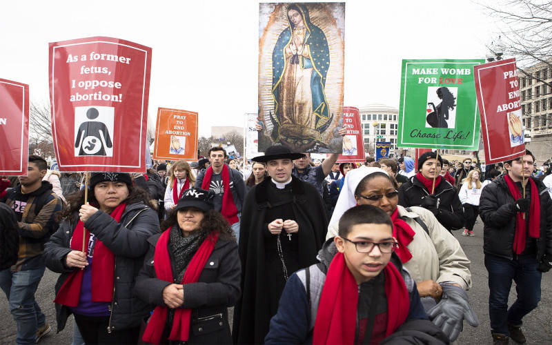 People walk up Constitution Avenue headed toward the U.S. Supreme Court while participating in the 47th-annual March for Life in Washington Jan. 24, 2020. The 2021 March for Life in Washington will be conducted virtually because of the coronavirus pandemic and ongoing political unrest in the nation's capital. (CNS photo by Tyler Orsburn)