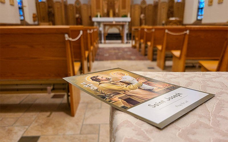 A prayer card for St. Joseph is seen at the Diocese of Rochester's Pastoral Center in Gates. (Courier photo by Jeff Witherow)