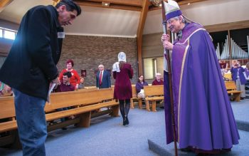 During the 2020 Rite of Election and Call to Continuing Conversion at St. Mary Our Mother Church in Horseheads, Bishop Salvatore R. Matano addresses Christian Woodruff of St. Mary of the Lake in Watkins Glen.