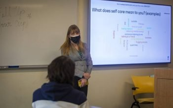 Shannon Boley, assistant director of the Office of Ministry and Spiritual Life at Marymount University in Arlington, Va., talks to students at the Catholic college March 17, 2021, about employing self-care during the coronavirus pandemic. (CNS photo by Chaz Muth)