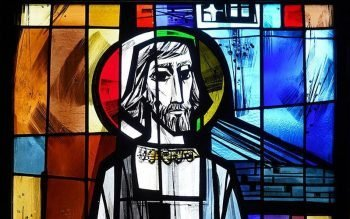 A depiction of St. Joseph holding a carpenter's square is seen in a stained-glass window in the chapel of St. Joseph's College in Patchogue, N.Y., in 2020. (CNS photo by Gregory A. Shemitz)