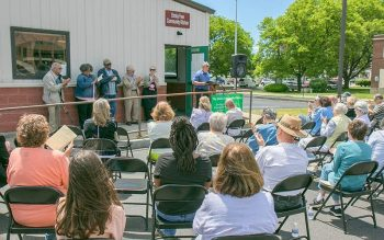 Elmira Mayor Dan Mandell issues a proclamation May 27 recognizing the 40th anniversary of Elmira Community Kitchen. (Photo courtesy of Katie Rhodes)