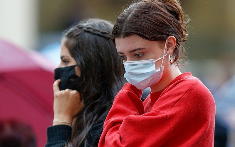 Young women wear masks as they attend Pope Francis' general audience in the San Damaso Courtyard of the Apostolic Palace at the Vatican May 19.
