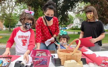 Lili Crowe (from left), Maria Crowe and Jem Crowe participate in one of the craft stations during the Pentecost Family Festival May 23 at Church of the Assumption in Fairport. (Courier photo by Jeff Witherow)