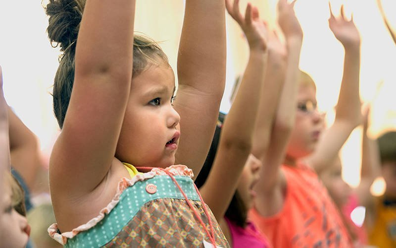 Zoe Trout sings a song July 19, 2017, during the vacation Bible school program sponsored by St. Francis & St. Clare Parish in Waterloo/Seneca Falls and Our Lady of Peace Parish in Geneva. (Courier file photo)
