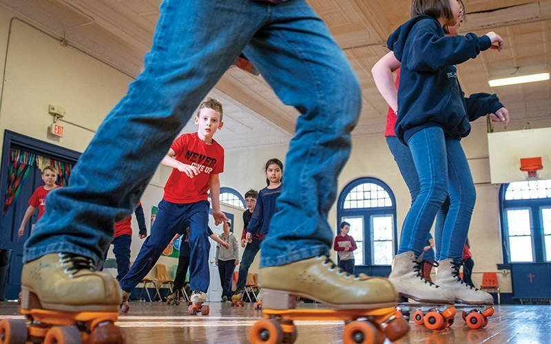 As part Catholic Schools Week 2020, Johnny Dowd skates with fellow St. Agnes School third-graders during a Jan. 30, 2020, roller-skating party at the Avon school. This photo received a first-place Catholic Media Association award in the Best Photograph-Catholic Education category.