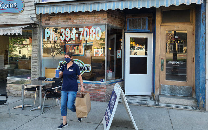 Parent-Teacher Organization member Kellie Parker leaves Mac's Philly Steaks on Main Street in Canandaigua during a May 18 fundraiser to benefit St. Mary School. (Courier photo by Jeff Witherow)
