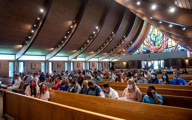 Members of Marion's Our Lady of Guadalupe Mission gather at St. Mary of the Lake Church in Ontario for a June 26 confirmation liturgy. (Courier photo by Jeff Witherow)