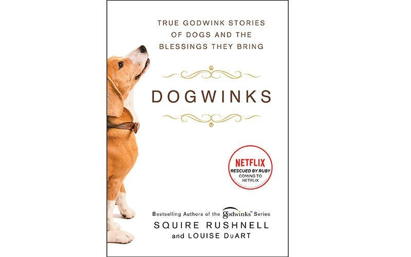 """This is the cover of the book """"Dogwinks: True Godwink Stories of Dogs and the Blessings They Bring,"""" by SQuire Rushnell and Louise DuArt. The book is reviewed by Regina Lordan. (CNS photo courtesy Howard Books)"""