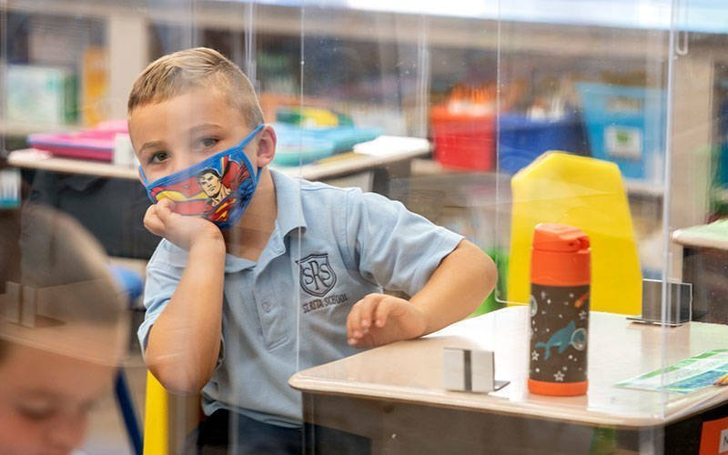 Noah DeStefano listens to his teacher while in class at St. Rita School in Webster Sept. 9, 2020. (Courier file photo)