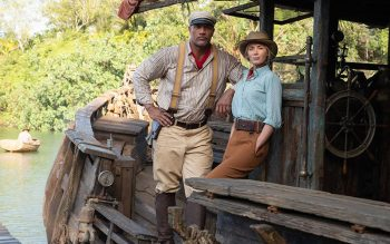 """Dwayne Johnson and Emily Blunt star in a scene from the film """"Jungle Cruise."""" The Catholic News Service classification is A-III — adults. The Motion Picture Association rating is PG-13 — parents strongly cautioned. Some material may be inappropriate for children under 13. (CNS photo by Frank Masi/courtesy Disney Enterprises)"""