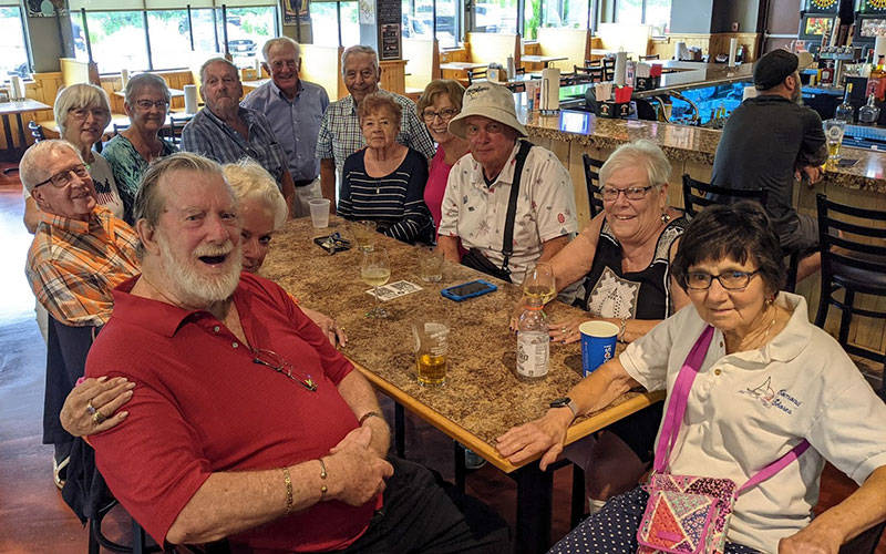 A group of smiling men and women sit around a table in a restaurant. Members of the Class of 1956 from the former St. Charles Borromeo School gathered for in June for their 65th reunion. From left to right are Tom Oakes (Joan), Karen Kuhns (Fred) Ackerman, Kathy McCaffrey (Mike) Owens, Pat (Barb) Maginn, Bev Liddy, Carol Newman (Bill) Sharpe and Jeff Gurtler (Carol). (Photo courtesy of Carol Sharpe)