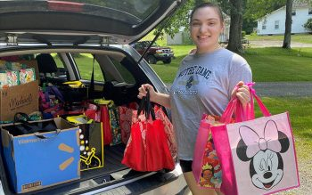 Kylee Bakley delivers her arts-and-crafts activity kits to Catholic Charities of Chemung/Schuyler. (Photo courtesy of Catholic Charities of Chemung/Schuyler)