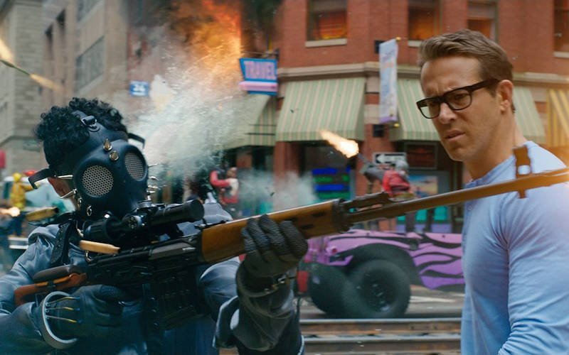 """Ryan Reynolds stars in a scene from the movie """"Free Guy."""" (CNS photo by 20th Century Studios)"""