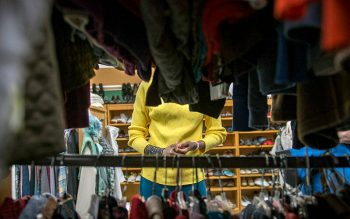 Esperence Batamuriza looks at items of clothing Oct. 18, 2017, at the Saint's Place clothing closet in Pittsford. (Courier file photo)