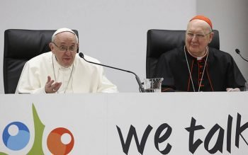 Pope Francis speaks at a pre-synod gathering of youth delegates in Rome in this March 19, 2018, file photo. Also pictured is U.S. Cardinal Kevin J. Farrell, prefect of the Vatican's Dicastery for Laity, Family and Life. Originally scheduled for 2022, the next meeting of the Synod of Bishops will take place in October 2023 to allow for broader consultation at the diocesan, national and regional levels. (CNS photo by Paul Haring)