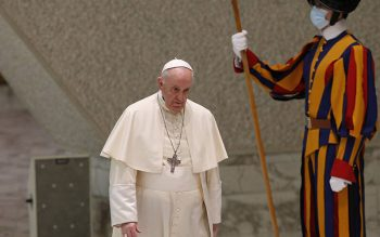 Pope Francis walks past a Swiss Guard as he arrives to lead his general audience in the Paul VI hall at the Vatican Sept. 8, 2021. (CNS photo by Paul Haring)