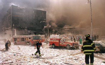 New York City firefighters and other emergency personnel survey the World Trade Center collapse Sept. 11, 2001. (CNS photo by Anthony Correia/Reuters)