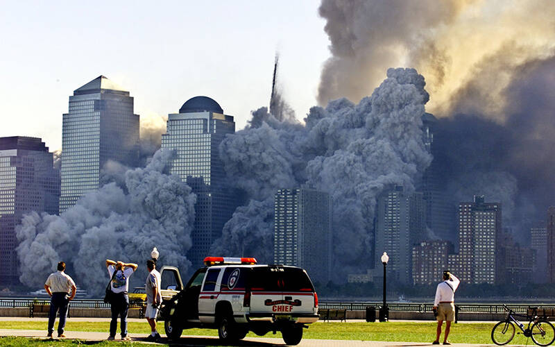 The remaining tower of New York City's World Trade Center, Tower 2, dissolves in a cloud of dust and debris about a half hour after the first twin tower collapsed Sept. 11, 2001. (CNS photo by Ray Stubblebine/Reuters)