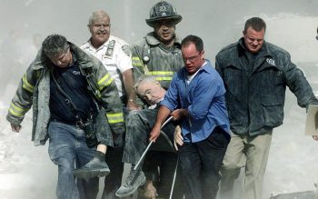 New York firefighters and rescue workers are seen Sept. 11, 2001, carrying Franciscan Father Mychal Judge, a chaplain with the New York Fire Department, who died while giving last rites to a firefighter in the aftermath of the terrorist attacks that brought down the twin towers of the World Trade Center. (CNS photo by Shannon Stapleton/Reuters)