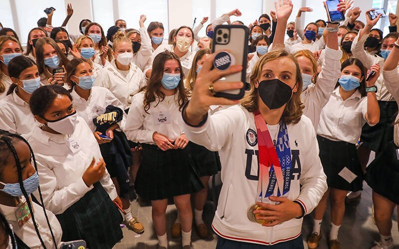 Katie Ledecky takes a selfie with students during her alma mater visit to Stone Ridge School of the Sacred Heart in Bethesda, Md., Sept. 17, 2021. (CNS photo by Andrew Biraj/Catholic Standard)