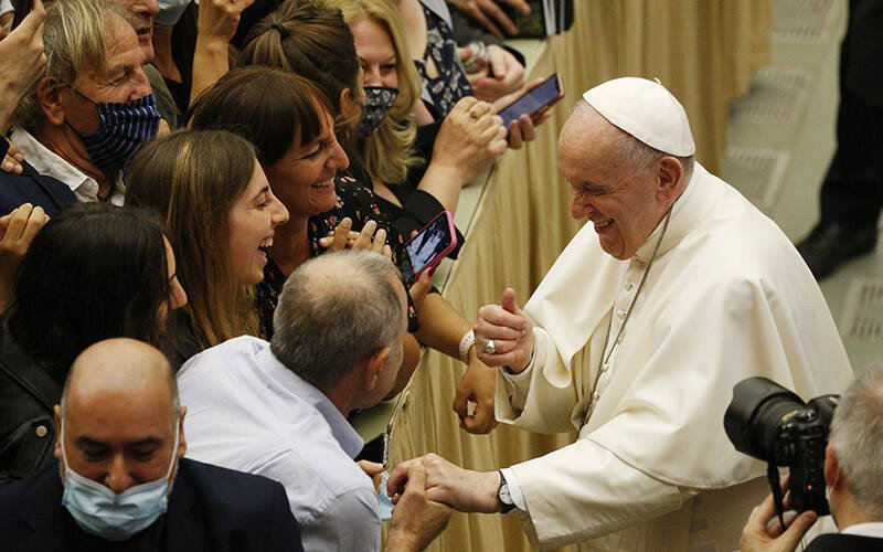 Pope Francis greets people during his general audience in the Paul VI hall at the Vatican Sept. 22, 2021. (CNS photo by Paul Haring)