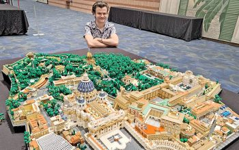 Rocco Buttliere, a Lego architect from Chicago, is seen next to the Vatican City State replica he created that was on display at the Lego BrickUniverse convention at the Pontchartrain Center in Kenner, La. (CNS photo by Peter Finney Jr./Clarion Herald)