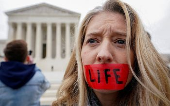 A pro-life activist is seen outside the U.S. Supreme Court building in Washington Jan. 24, 2020. (CNS photo by Kevin Lamarque/Reuters)