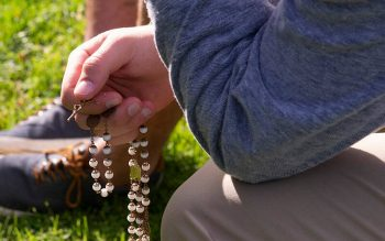 Aiden Nasca prays the rosary during a Oct. 13, 2019 Rosary Coast to Coast rally at Rochester's Holy Cross Church.