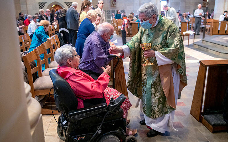 Barb Kristan receives Communion from Bishop Salvatore R. Matano during the Oct. 3 Respect Life Mass at Rochester's Sacred Heart Cathedral. (Courier photo by Jeff Witherow)
