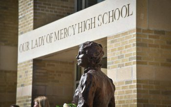 A bronze statue of Sisters of Mercy founder Catherine McAuley was installed on a stone base at the main entrance to Our Lady of Mercy School for Young Women in Brighton. (Photo courtesy of Dave Carro)