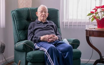 An elderly man sits in a green recliner in front of a window. Chet Palinski is seen in his home in Greece Feb. 18, 2021. He was honored posthumously by the Knights of Columbus Council 3892 in Greece. (Courier file photo)