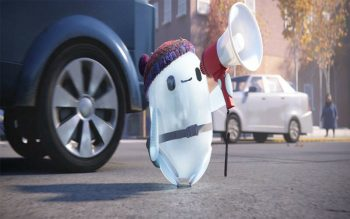 """An animated toy robot that looks like a round white ghost is dressed in a knit hat and holds a megaphone. This is a scene from the animated movie """"Ron's Gone Wrong."""" The Catholic News Service classification is A-I — general patronage. The Motion Picture Association rating is PG — parental guidance suggested. Some material may not be suitable for children. (CNS photo by 20th Century Studios via EPK TV)"""