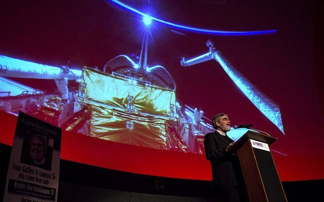 Jesuit Brother Guy Consolmagno, director of the Vatican Observatory, delivers the 2017 Catholic Courier Lecture Oct. 5 at Strasenburgh Planetarium in Rochester.  (Courier photo by Jeff Witherow)