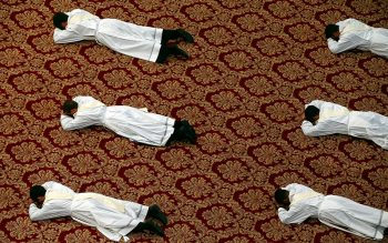Candidates for the priesthood lie prostrate during their ordination by Pope Francis in St. Peter's Basilica at the Vatican April 22. (CNS photo by Tony Gentile/Reuters)
