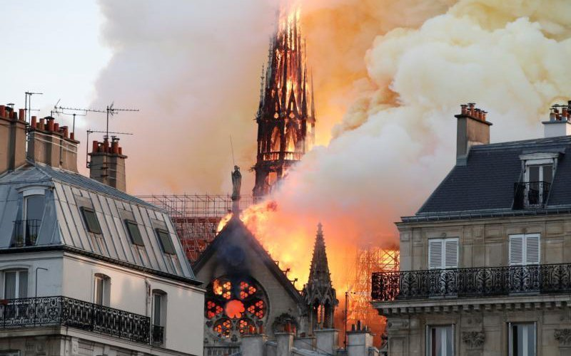 Flames and smoke billow from the Notre Dame Cathedral after a fire broke out in Paris April 15, 2019. Officials said the cause was not clear, but that the fire could be linked to renovation work. (CNS photo by Benoit Tessier/Reuters)