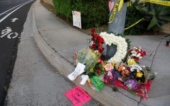 """A makeshift memorial is displayed April 27, 2019, near a shooting incident at the Congregation Chabad synagogue in Poway, Calif., near San Diego. In response to the shooting, Cardinal Daniel N. DiNardo of Galveston-Houston and president of the U.S. Conference of Catholic Bishops, said in an April 28 statement: """"Our country should be better than this; our world should be beyond such acts of hatred and anti-Semitism."""" (CNS photo by John Gastaldo/Reuters)"""