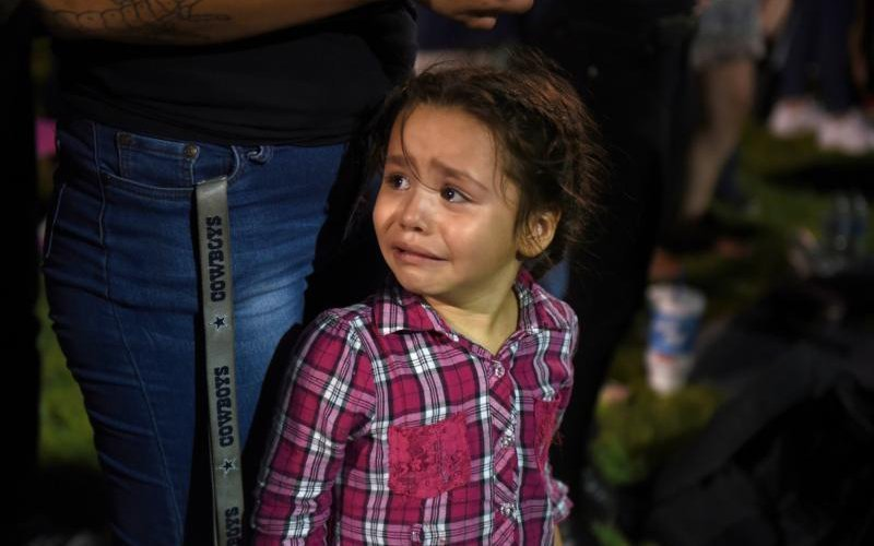 Serenity Lara cries during an Aug, 4, 2019, vigil, a day after a mass shooting at a Walmart store in El Paso, Texas. (CNS photo by Callaghan O'Hare/Reuters)