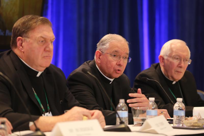 Archbishop Jose H. Gomez of Los Angeles, president of the U.S. Conference of Catholic Bishops, responds to a question during a news conference at the fall general assembly of the USCCB in Baltimore Nov. 12, 2019. Also pictured are: Cardinal Joseph W. Tobin of Newark, N.J., and Archbishop Leonard P. Blair of Hartford, Conn.