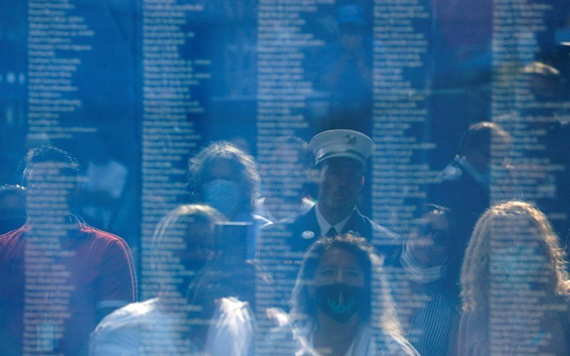 People in New York City view the names of 9/11 victims while attending ceremonies Sept. 11, 2020, to marking the 19th anniversary of the terrorist attacks on the World Trade Center.