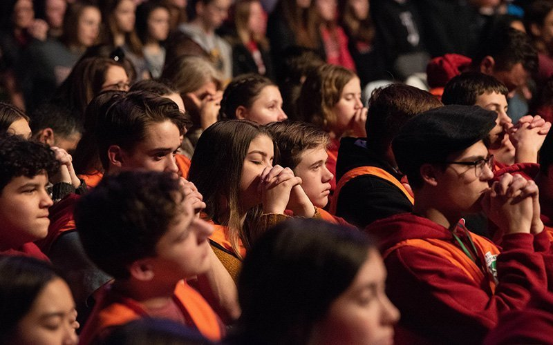 """Teens pray during adoration at a """"Life is VERY Good"""" event at EagleBank Arena in Fairfax, Va., Jan. 23, 2020."""