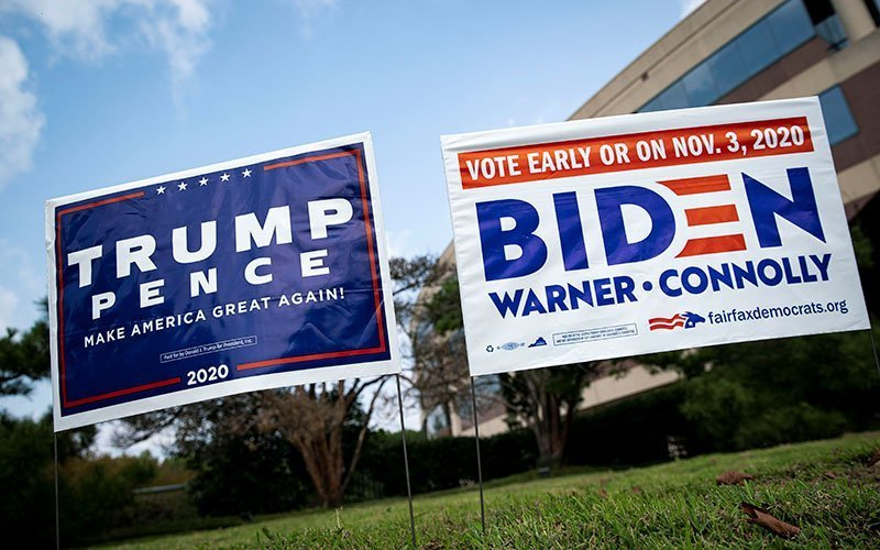 Election yard signs are seen outside of an early voting site in Fairfax, Va., Sept. 18, 2020.