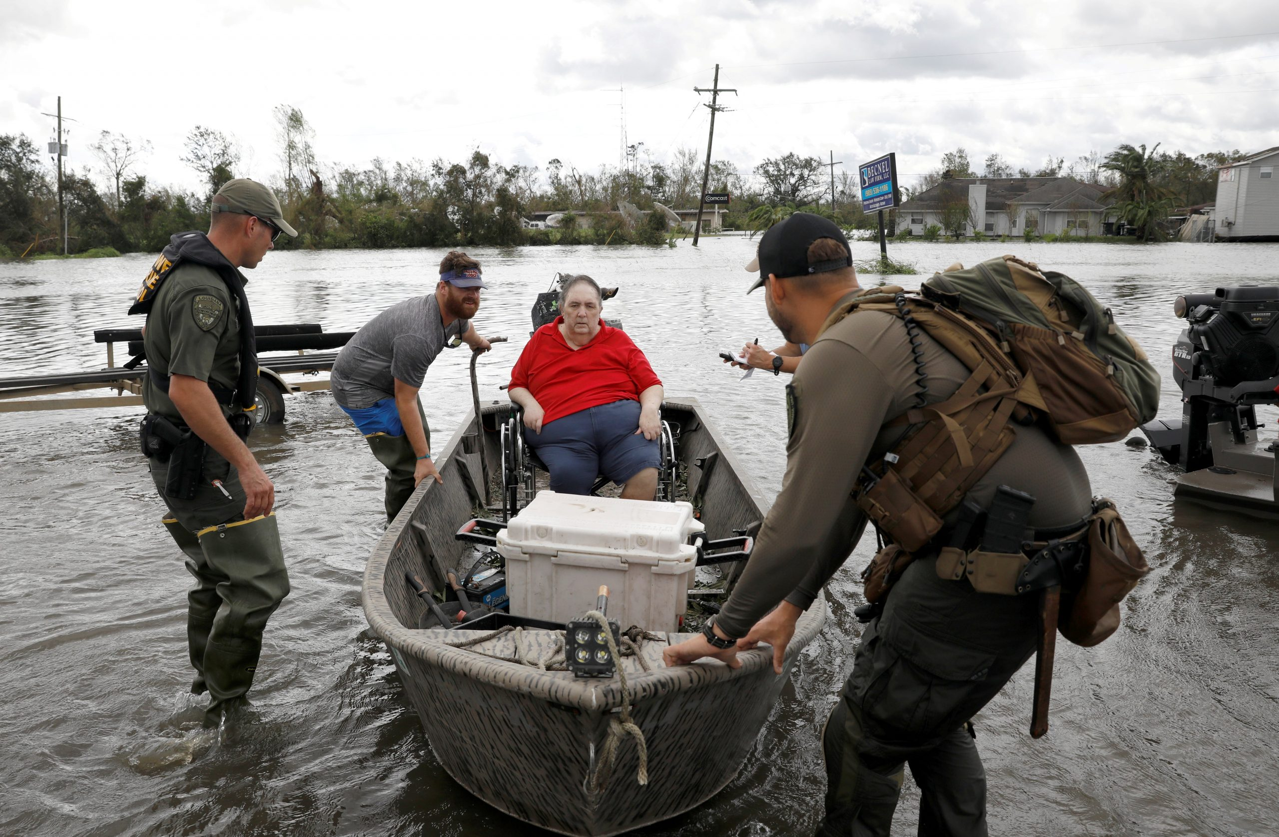 Members of a rescue team in Laplace, La., help evacuate people Aug. 30, 2021, after Hurricane Ida made landfall.