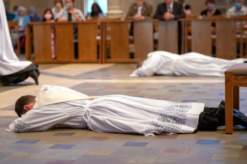 Then-Deacons Steven Lewis and Joseph Maurici prostrate themselves before the altar.