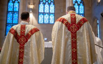 Fathers Maurici and Lewis face the altar during the Liturgy of the Eucharist.
